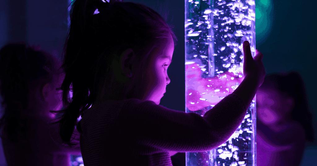 Child holding sensory light tube