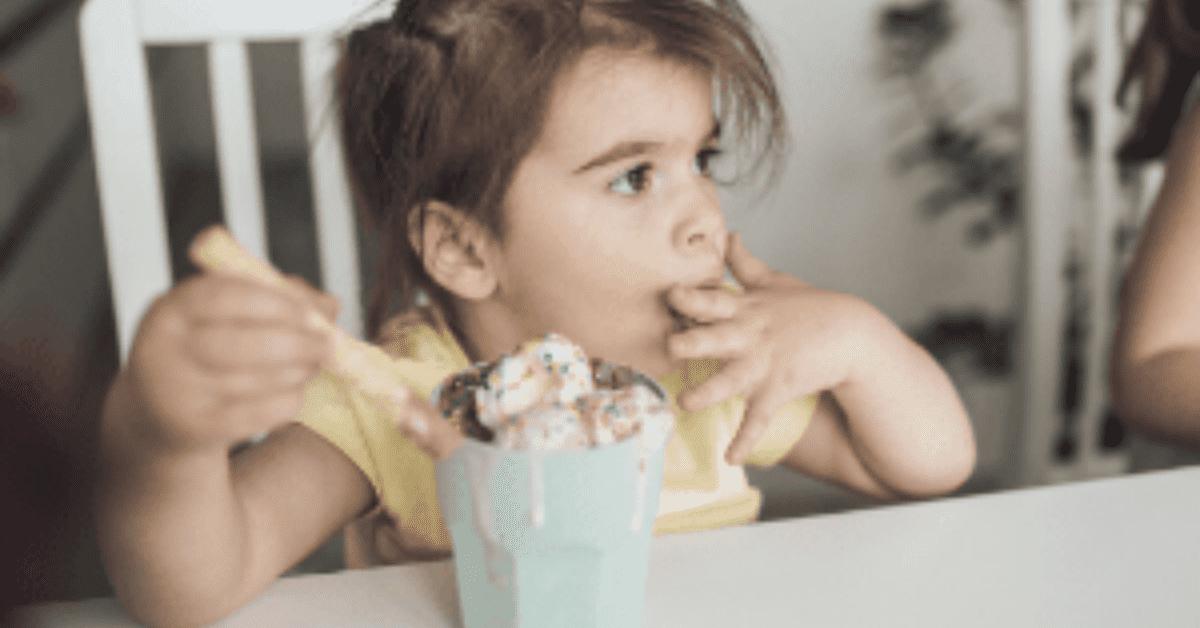 Toddler eating ice cream
