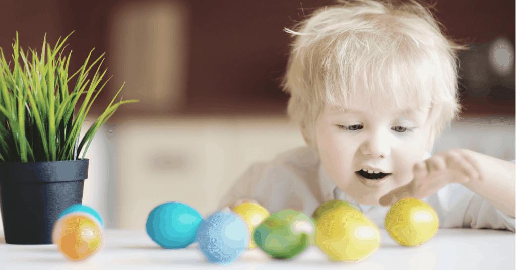 Child eating easter eggs