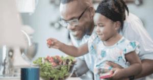 parent and child making salad