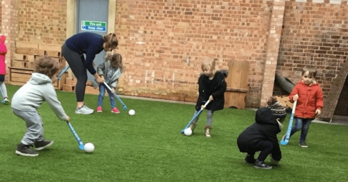 Fennies Nurseries children playing hockey