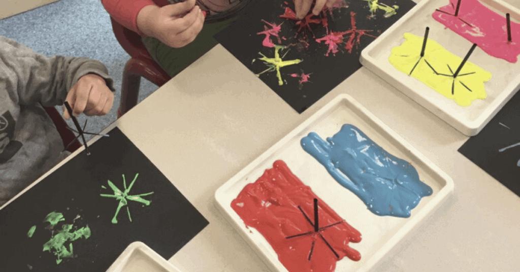 children painting Holi fireworks artwork