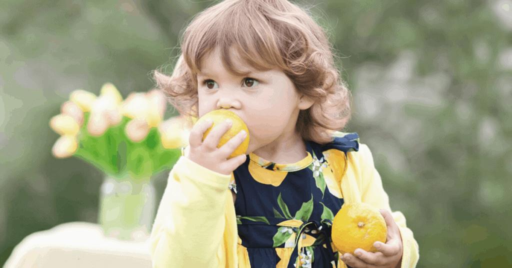 Child eating an orange