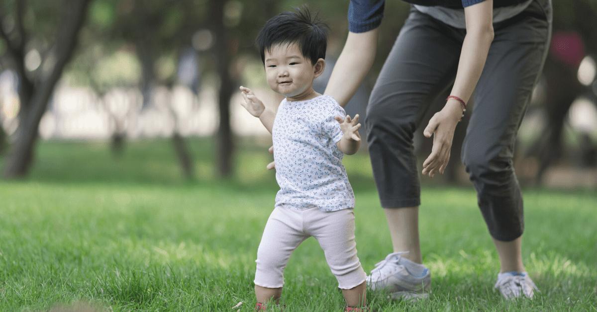Toddler walking outside