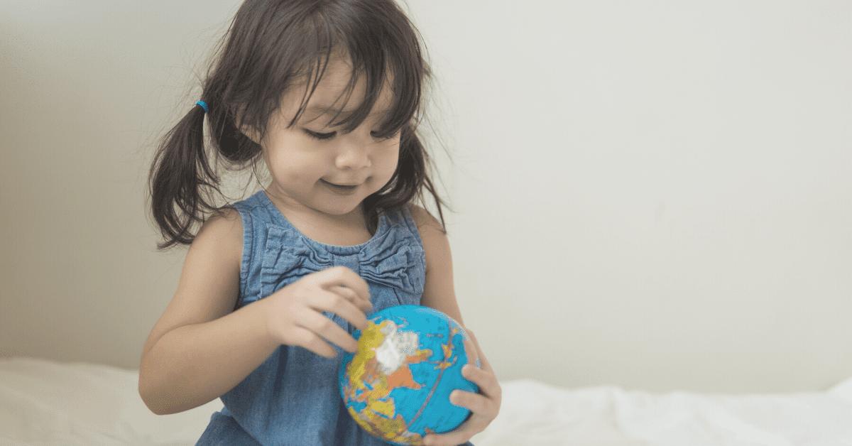 toddler holding globe