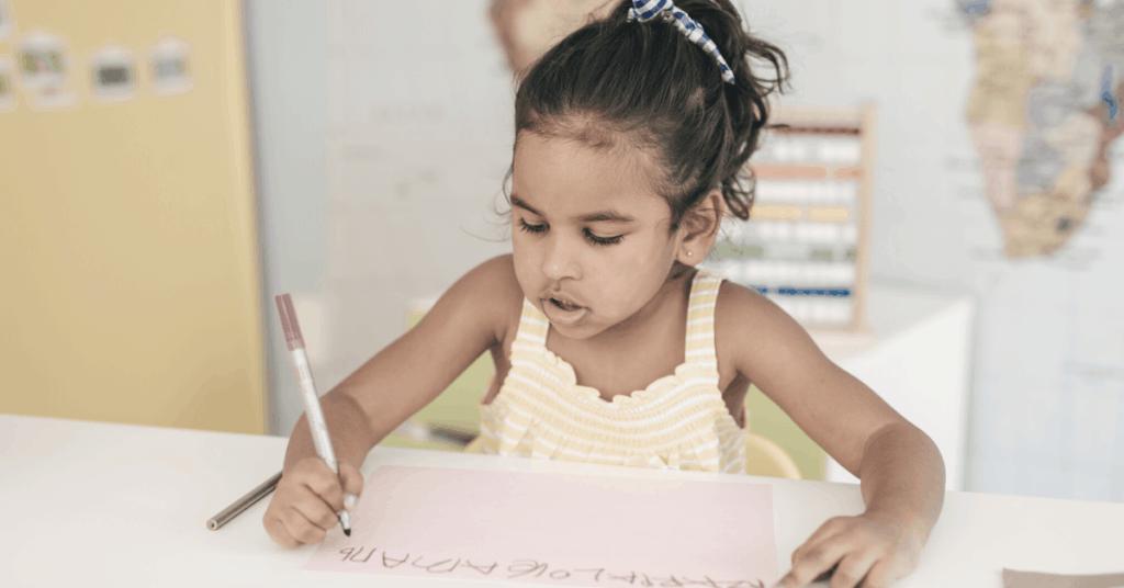 child writing at nursery
