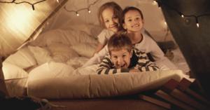 Children in a blanket fort