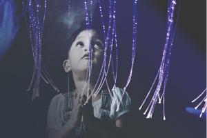 Child holding optic lights