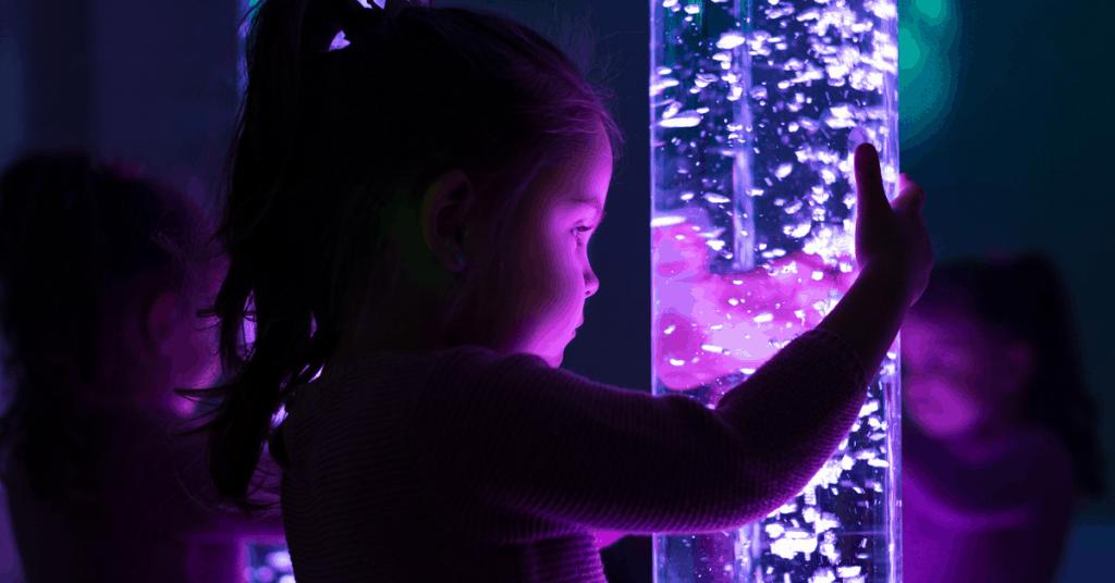 Child holding mood tube